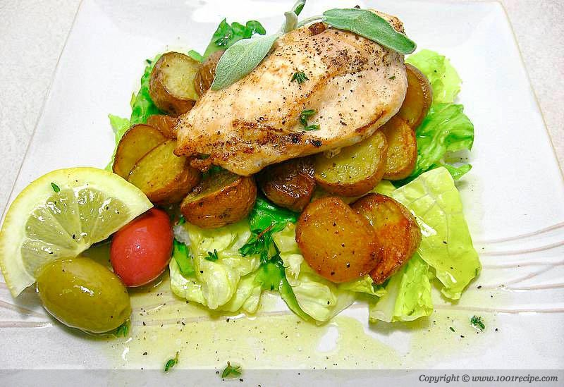 Pan fried chicken with thyme and roasted potatoes Photo