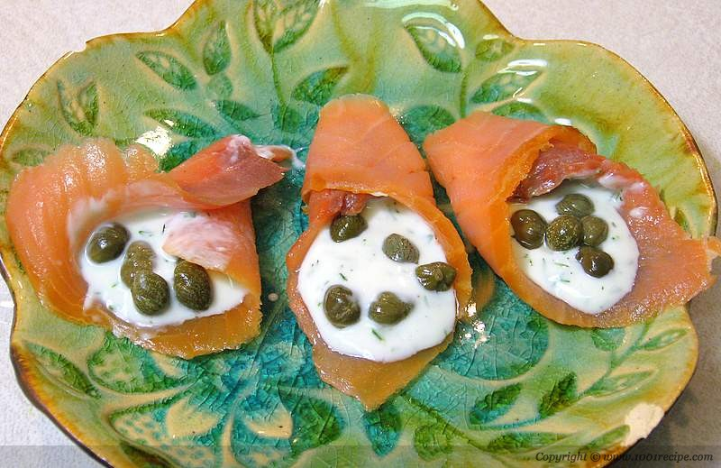 Smoked salmon with capers and dill sauce Photo